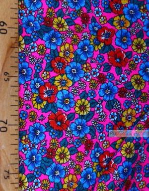 Tissu coton fleuri au metre ''Wild Flowers On A Pink Field''}