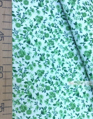 Tissu coton fleuri au metre ''Small Green Flowers On The Dairy Field''}