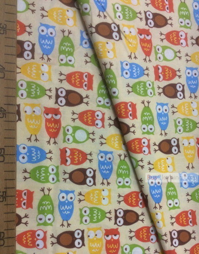 Tissu pour enfant au metre ''Colored Owlets On The Sand''}